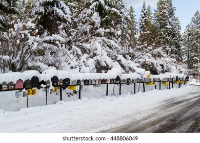 Coeur d' Alene, Idaho - December 30: Line of mailboxes set up on the road covered in snow and wintery record conditions, December 30 2016 in Coeur d' Alene, Idaho
