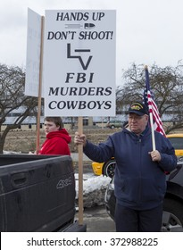 Coeur d'Alene, Idaho - 02-06-2016. Father and son hold signs at a rally for Lavoy Finicum being held in Coeur d'Alene, Idaho on February 6, 2016.