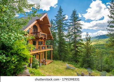 Coeur d'Alene, Idaho - July 30 2020: A 3 story log home with decks in the mountains near Coeur d'Alene, Idaho, USA