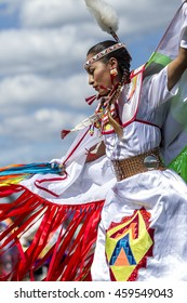 Coeur d'Alene, Idaho USA - 07-23-2016. Young woman at Native American Powwow. Young dancer participates in the Julyamsh Powwow on July 23, 2016 in Coeur d'Alene, Idaho.