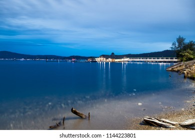 COEUR D'ALENE, IDAHO, USA - JULY 4, 2018: The Cedars floating restaurant on Lake Coeur d'Alene at twilight on the Fourth of July in Coeur d'Alene, Idaho.