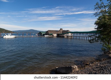 COEUR D'ALENE, IDAHO, USA - JULY 4, 2018: The Cedars floating restaurant on Lake Coeur d'Alene with a boat at their dock on the Fourth of July in Coeur d'Alene, Idaho.