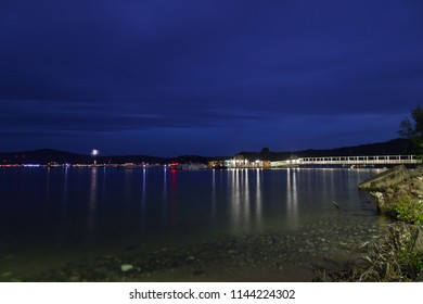 COEUR D'ALENE, IDAHO, USA - JULY 4, 2018: The Cedars floating restaurant on Lake Coeur d'Alene at twilight with boats and fireworks in the background on the Fourth of July in Coeur d'Alene, Idaho.