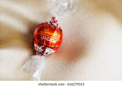 Coeur d'Alene, Idaho/United States - March 20 2014: Lindt by Lindor wrapped chocolate bonbon on a satin background.