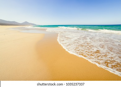 Cofete beach, Fuerteventura, Canary Islands, Spain. Amazing Cofete beach with endless horizon. Volcanic hills in the background and Atlantic Ocean.