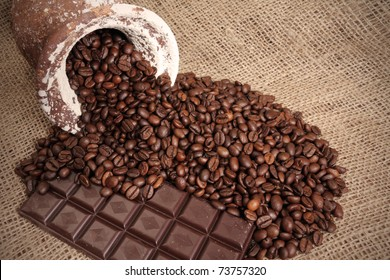 coffe beans on jute background with chocolate