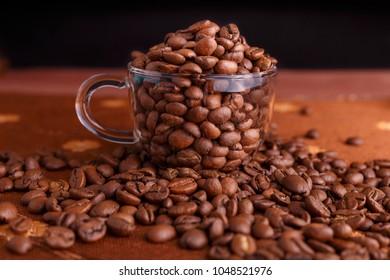 coffe beans in transparent mug on burlap background