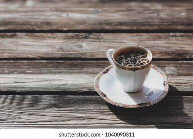 Coffe cup with coffe beans
