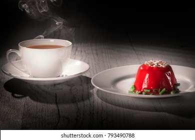 coffe cup with smoke to the wood table on black background