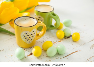 Coffe in green and yellow cups, tulips