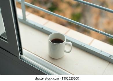 Coffe mug and autumn window view