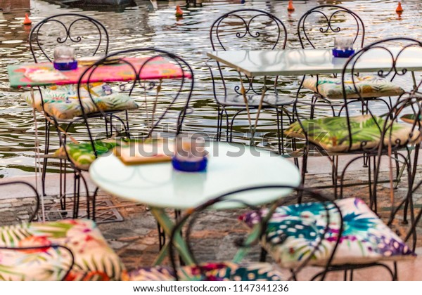 coffe tables on waters of port channel