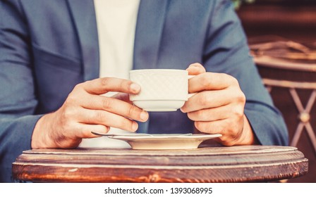 Coffe time. Hand of man hold coffee or coffe cup at cafe in the morning. Cup of coffee. Coffee drink. Close up of a man hands holding a hot coffe cups.