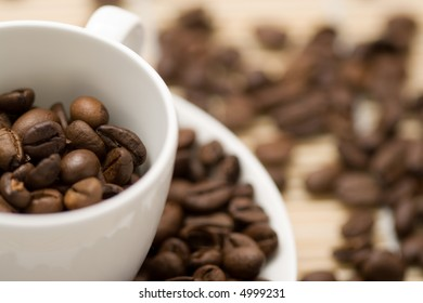 coffecup filled with cofeebeans