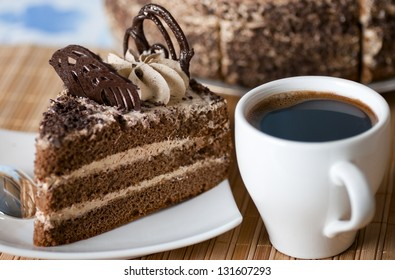 coffee ,a slice of cake on the plate on the background of cake