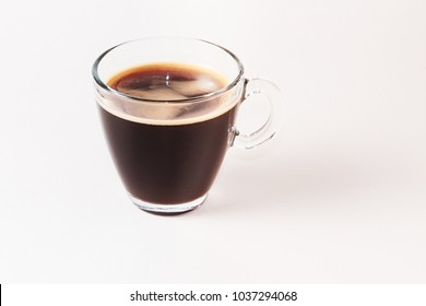 Coffee Americano in Glass small cup with foam white background