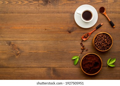 Coffee background. Coffee beans and hot drink, top view