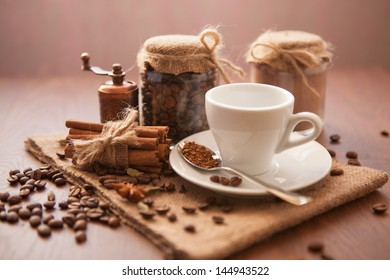 Coffee background with coffee beans and white cup