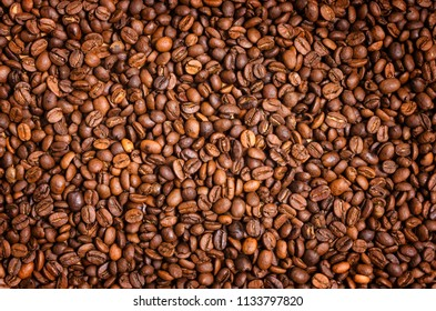 Coffee background. Brown roasted coffee beans.