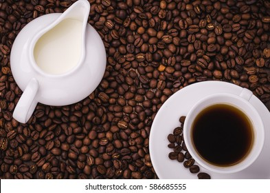 coffee background with cup and creamer/coffee background with cup and creamer top view