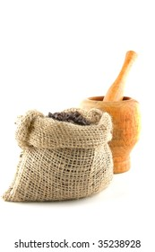 coffee bag full of beans with pestle over white