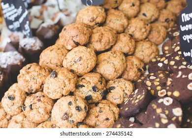 coffee and bakery shop bar with mix of tasty fresh baked chocolate oatmeal pastry with nuts