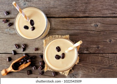 Coffee, banana smoothie in two glasses. Top view, corner orientation over a rustic wood background,