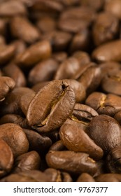 A coffee bean against a unsharpened background