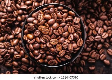 Coffee bean in a closeup macro on a dark background, top view
