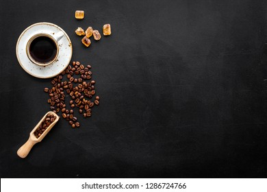 coffee bean and cup of americano on black table background top view mockup