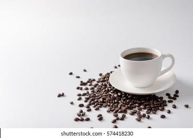 Coffee bean in the cup with black coffee