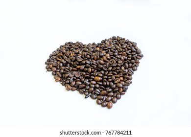 Coffee bean in a heart shape on white background
