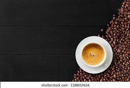 coffee bean on black wood background. top view