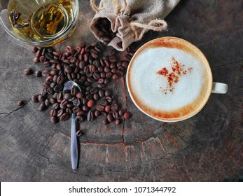 Coffee bean on an old wooden table,symbol of start  energy in a new day