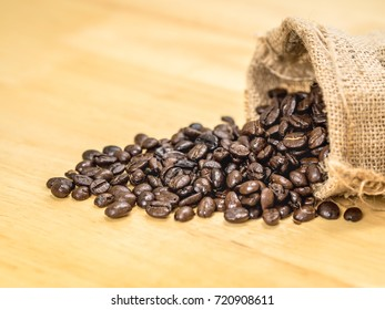 Coffee bean on top wooden table with sack