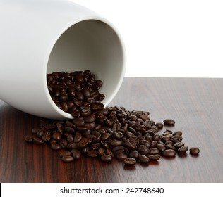 Coffee bean on wood texture isolated on white background