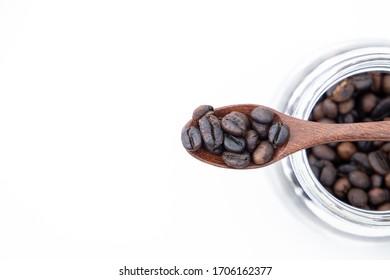 coffee bean on wooden spoon.