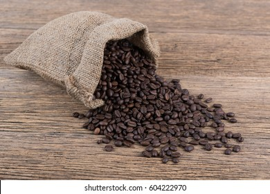 coffee bean out of sack on wood