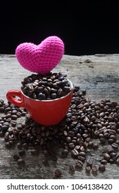 Coffee bean in the red cup with pink heart.