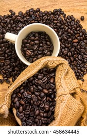 coffee bean with bean sack and cup on wood background