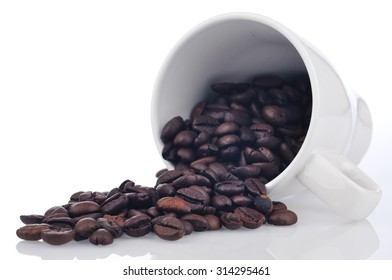 Coffee Bean Spill Out From Cup On White Background, Selective Focus
