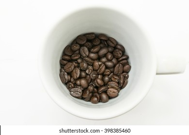 coffee bean of white background and in the cups and spoon