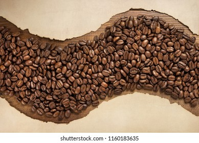 coffee beans and aged old paper on wooden background, top view