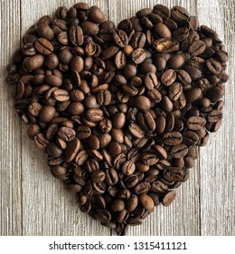 Coffee beans arranged in a heart shape in a square frame