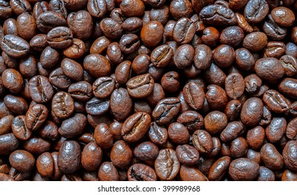coffee beans in the background.
