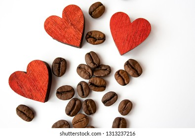 Coffee beans background and red hearts