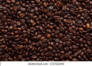 Coffee beans background. Background of roasted coffee beans - Shutterstock ID 1717221496