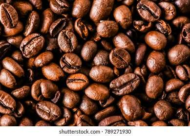Coffee beans background. Rousted coffee beans. Close up of coffee beans