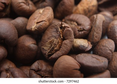 Coffee beans background or texture (shallow DOF)