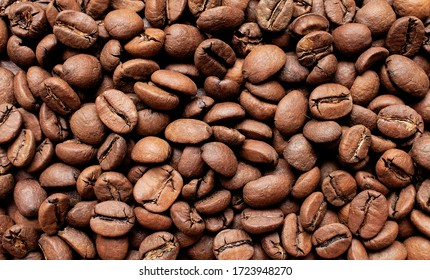 coffee beans background. the texture of the coffee. solid background of coffee beans. the technique of brewing. beans. background for coffee shops.
